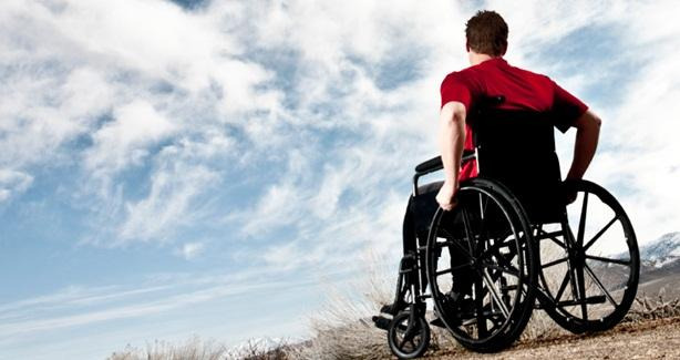 photo of young man in wheel chair