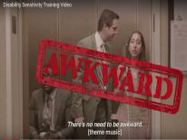 Screen shot from disability sensitivity training video, 3 people, one in a wheelchair, one standing, and one who is blind stand in elevator. In bold red letters it says Awkward